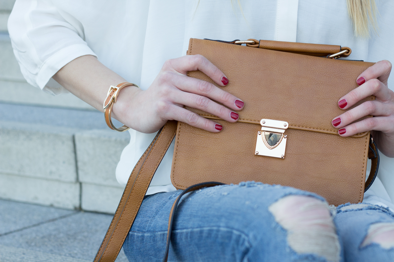 bag from Even & Odd and bracelet from mint in cognac