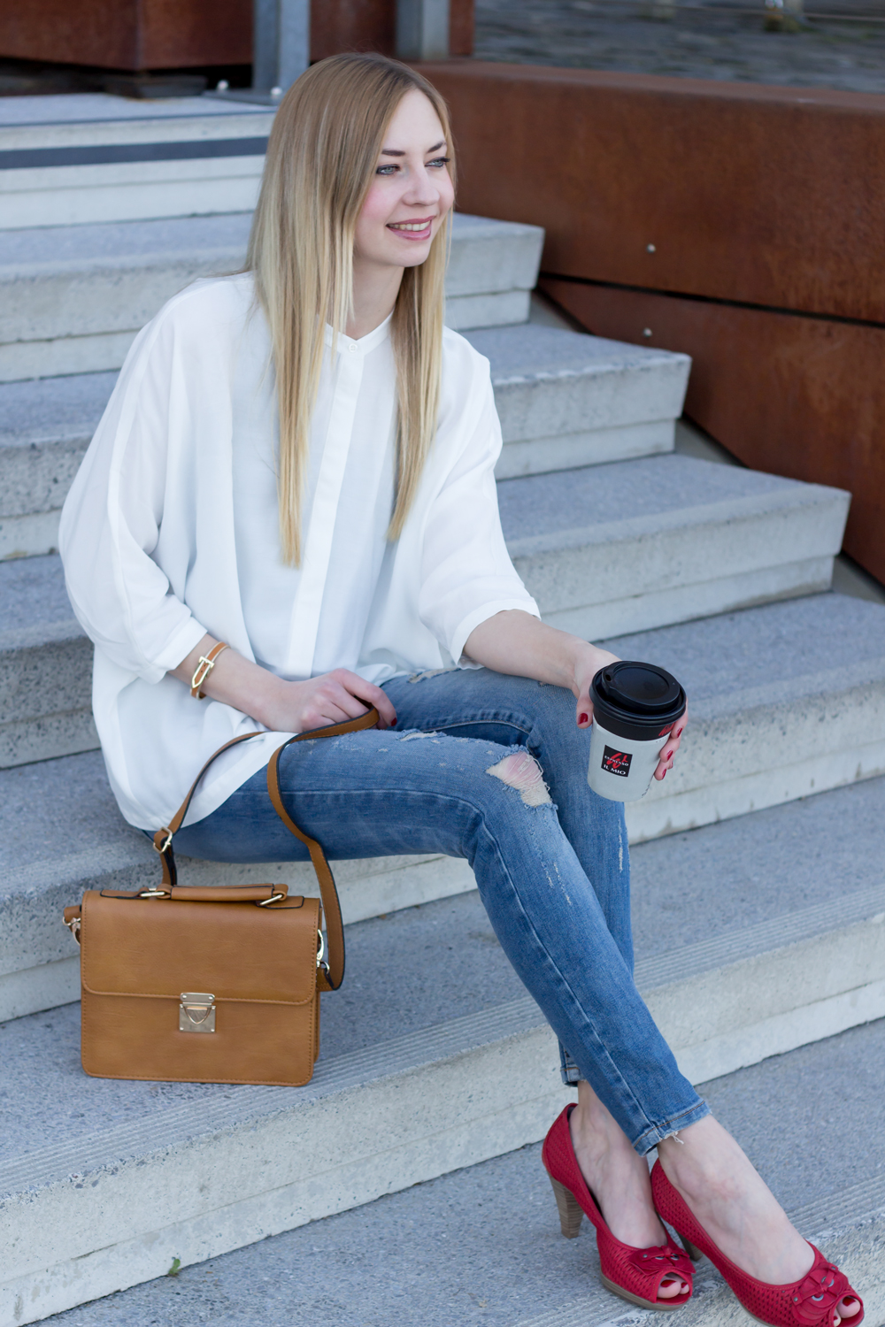 distressed jeans from Noisy May Lucy, white blouse from asks and a coffee to go