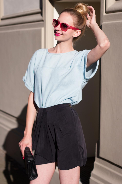 Denim shirt & black mini skirt.
