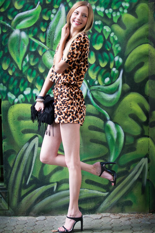 leopard shirt & shorts, black sandals and fringed bag