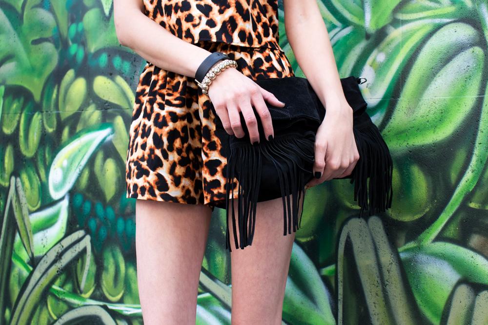 details: black fringed bag & golden bracelets