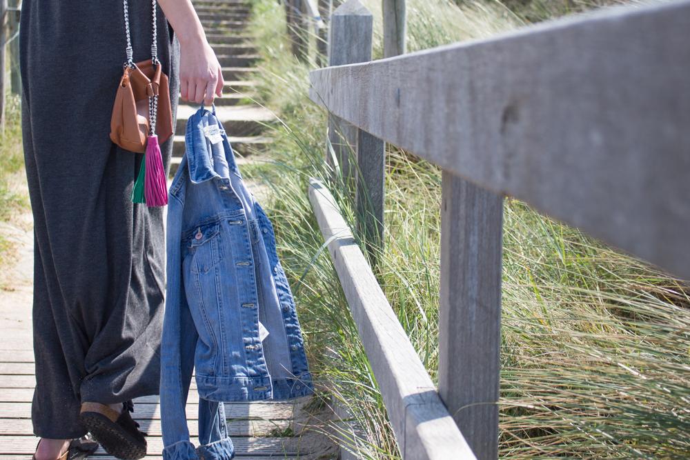 details: denim jacket, birkenstock shoes & brown bag with colorful fringes